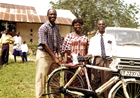 Eugene presents bicycle to  leaders of the local village church.