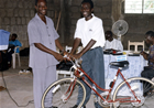Grateful and overjoyed for the answered prayer, Samuel Terkpeh(District Pastor of the Baptist Church at Asesewa in the Dangme North district) can barely contain his happiness as he receives this bicycle from Eugene