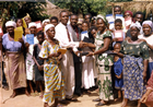 Emma (Eugene's wife) helps distribute Bibles and other Christian literature to new converts. - Volta Region, Ghana