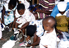 Happy children try on new shoes. Shoes that they can now wear to school and Church